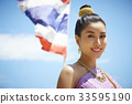 The portrait of Thai girl smiling with a flag behind 33595190
