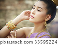 The portrait of Thai girl looking at something and thinking 33595224