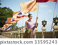 A photo of Thai woman posing on the balcony in the morning. 33595243