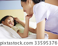 A happy moment of a nurse and a kid patient in a hospital 33595376