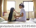 nurse and child patient are sitting and talking together on hospital bed 33595460