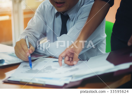 Clossup picture of a handsome businessman planning a laptop job 33595624