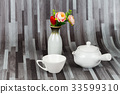 white tea pot and cup on wood 33599310
