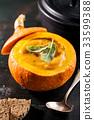 Creamy pumpkin soup puree in the whole squash 33599388