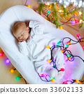 One week old newborn baby girl sleeping near 33602133