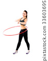 Woman training with hula hoop isolated on white 33603695