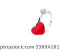 diamond ring and a red felt heart on white 33604161