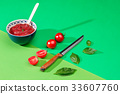 Bowl of chopped tomatoes on green table 33607760
