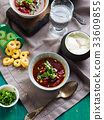 Beetroot soup served in bowls on napkin 33609855