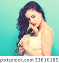 Young woman with flowers 33610185