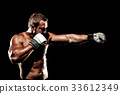 Sportsman muay thai boxer fighting in boxing cage. Isolated on b 33612349
