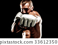 Sportsman muay thai boxer fighting in boxing cage. Isolated on b 33612350