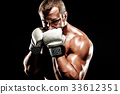 Sportsman muay thai boxer fighting in boxing cage. Isolated on b 33612351