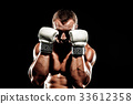 Sportsman muay thai boxer fighting in boxing cage. Isolated on b 33612358