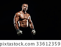 Sportsman muay thai boxer fighting in boxing cage. Isolated on b 33612359