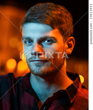 Night portrait of hipster man 33615633