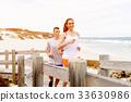 beach, couple, jogger 33630986