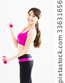 happy fitness woman working out with dumbbells 33631656