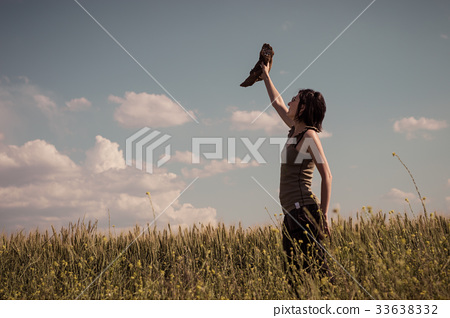 Young woman with hat enjoying the nature.  33638332