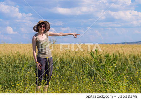 Young woman with hat enjoying the nature.  33638348