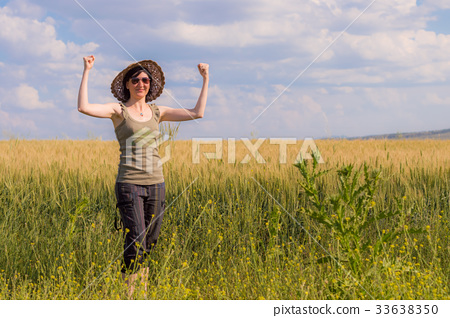 Young woman with hat enjoying the nature.  33638350