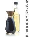 Soy sauce and vinegar bottle. 33638949