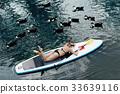woman on the Standup paddlbordingon lake 33639116