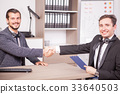 Business partners shaking hands in the office 33640503