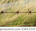Close up of old barbed wire. 33652345