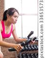 woman use exercise bike 33653573