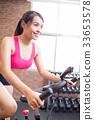 woman use exercise bike 33653578