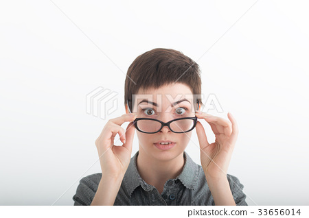 Strict woman in grey shirt and large glasses on 33656014