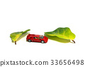 A red sport toy car with two petals in between. 33656498