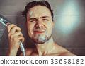 Young man washing head 33658182