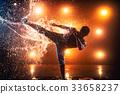 Young man kick 33658237