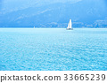 Lake, sailboat and mountains 33665239