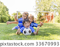 three, Young boy with soccer ball on a sport 33670993