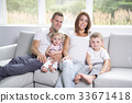 Beautiful family portrait sitting in the living 33671418