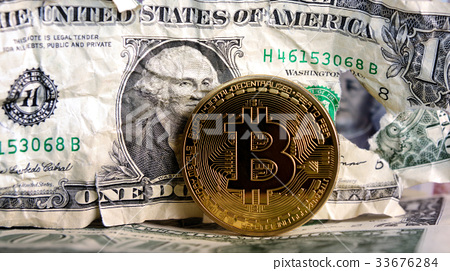 Bitcoin on Crushed dollar banknote 33676284