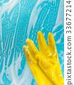 gloves in foam on a blue background 33677214
