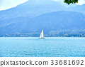 Lake, sailboat and mountains 33681692