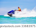 Teenager on water scooter. Teen age boy water ski 33683975
