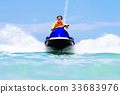 Teenager on water scooter. Teen age boy water ski 33683976