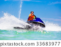 Teenager on water scooter. Teen age boy water ski 33683977