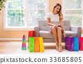 Young woman with many brightly colored shopping 33685805