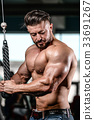 Handsome athletic man on diet training muscles 33691267