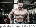 Handsome athletic man on diet training muscles 33691272
