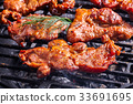 Grilling pork steaks on barbecue grill 33691695