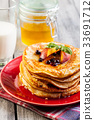 Pancakes with honey, fruit and glass of milk 33691712
