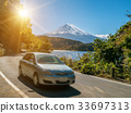 Car driving near Mt Fuji in Japan with motion blur 33697313